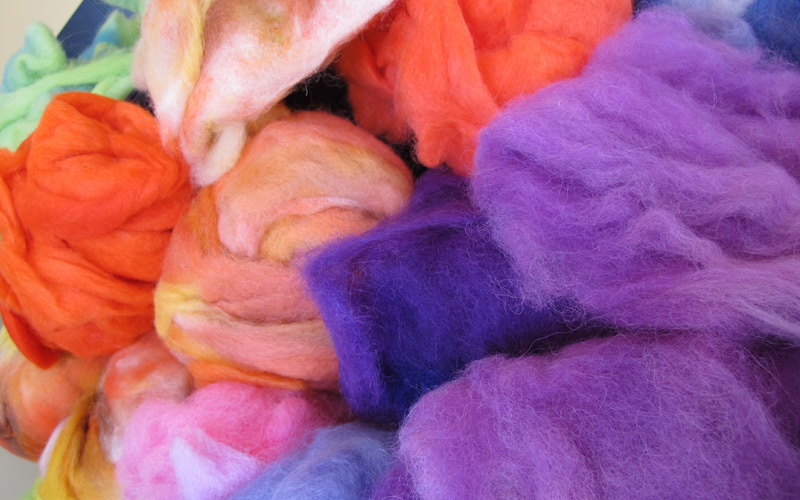 A group of hand-dyed alpaca fabric in bright colours
