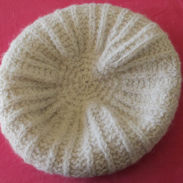 A white knitted beret hat