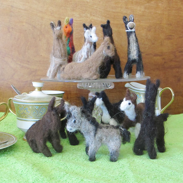 A group of needle felted llama, alpaca and donkey toys