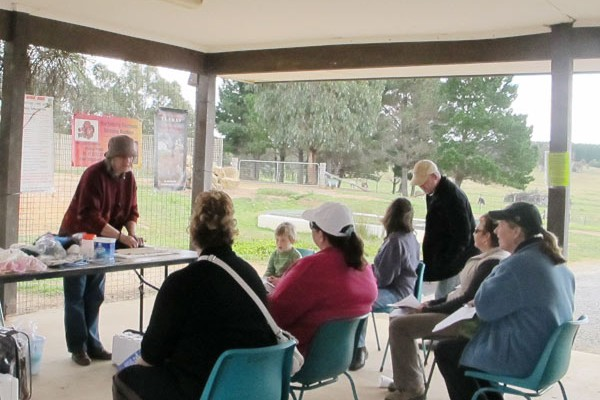 A class or talk being held at an Alpaca Magic open day.