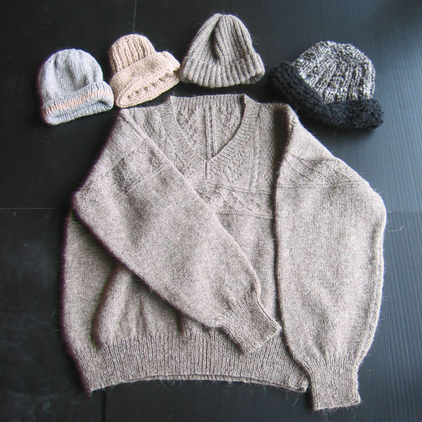 a knitted llama wool jumper and a range of matching beanies